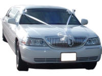 Cars for Stars (Oxford) - Wedding Limo. White Lincoln stretched wedding limousine with white ribbons